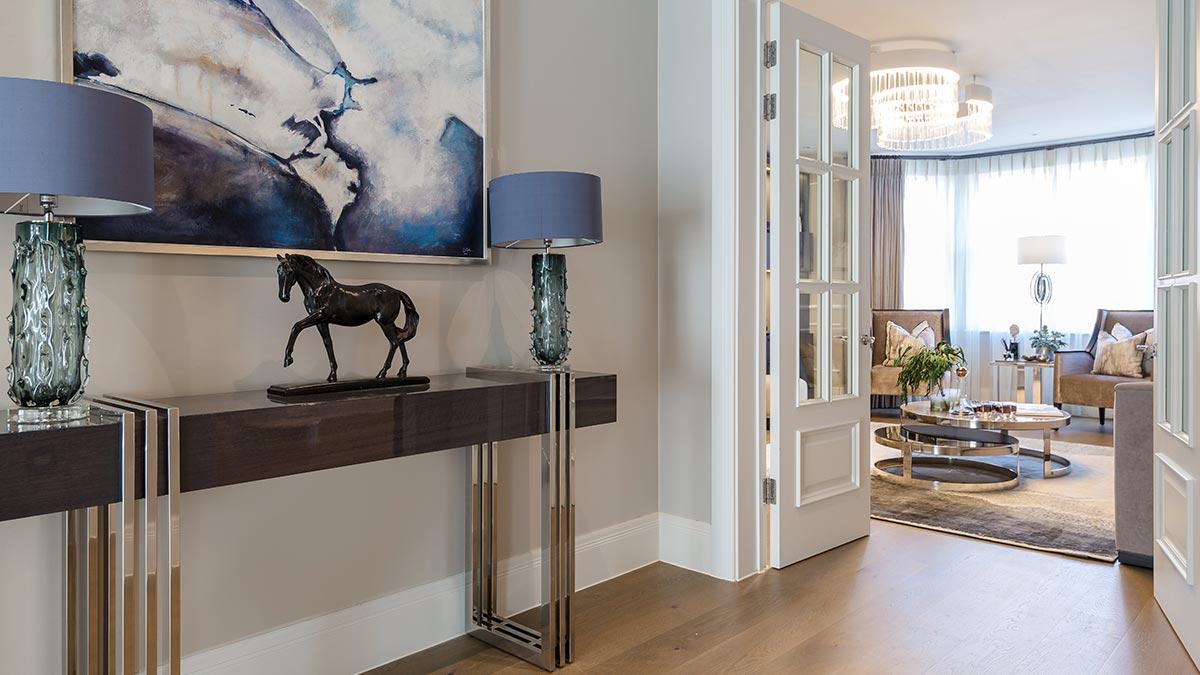 Interiors focused on soft, earthy tones combined with premium metallic